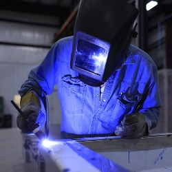 Nikiski Alaska welder welding in fabrication shop