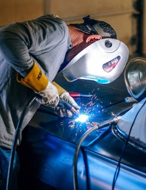 Fishhook Alaska welder working in car shop