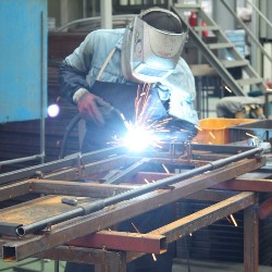 welder welding metal table