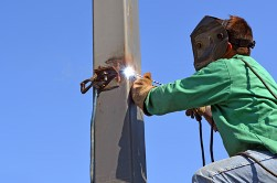 welder welding electrical pole